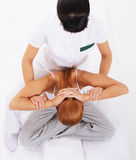 A young redhead woman on a Thai massage procedure Stock Photography