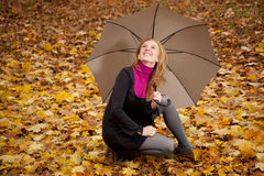 Young redhead woman with umbrella Royalty Free Stock Photos