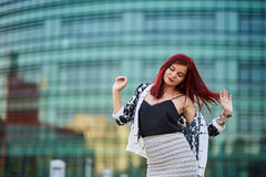Redhead lady in urban environment Royalty Free Stock Photography