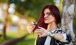 Redhead lady in urban environment Stock Photos