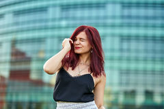 Redhead lady in urban environment Royalty Free Stock Images