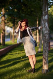 Redhead lady in urban environment Stock Photography