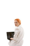 Young redhead woman using a laptop Stock Photography