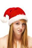 Young redhead woman wearing santas hat Royalty Free Stock Photography