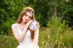 Young redheaded girl smiling and hold dreamcatcher Royalty Free Stock Photo