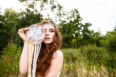 Young redheaded girl smiling and hold dreamcatcher Royalty Free Stock Photography