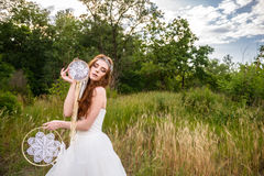 Young redheaded girl smiling and hold dreamcatcher Stock Photography