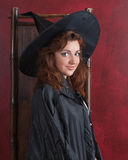 Young redheaded witch Royalty Free Stock Photography