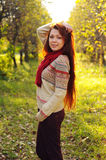 Young redheaded woman with long straight hair in the apple garde Stock Photo