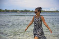 Young relaxed Asian Chinese woman walking on Thailand island beach with amazing beautiful turquoise color water under a summer blu. E sky in holiday and vacation Stock Photos