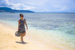 Young relaxed Asian Chinese woman walking on Thailand island beach with amazing beautiful turquoise color water under a summer blu. E sky in holiday and vacation Royalty Free Stock Photos