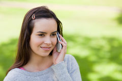 Young relaxed girl talking on the phone Royalty Free Stock Images