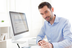 Young relaxed man using computer Royalty Free Stock Images