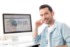 Young relaxed man using computer Royalty Free Stock Image