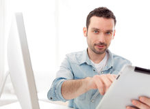 Young relaxed man using tablet at home Stock Photo