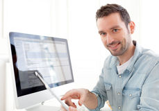 Young relaxed man using tablet at home Royalty Free Stock Photos