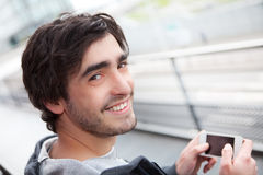 Young relaxed man writting text in the street Royalty Free Stock Image