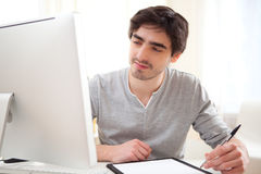 Young relaxed men writting at the office Royalty Free Stock Images