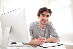 Young relaxed men writting at the office Royalty Free Stock Photography