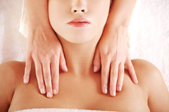 Young relaxed woman enjoy receiving massage. Beautiful young relaxed woman enjoy receiving massage at spa saloon Stock Image