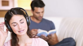 Young relaxed woman listening to music stock video footage