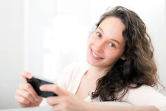 Young relaxed woman sending text Royalty Free Stock Images