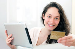 Young relaxed woman shopping on a tablet Royalty Free Stock Image