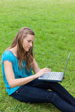 Young relaxed woman using her laptop Royalty Free Stock Photo