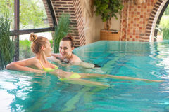 Young relaxed women in the swimming pool. Two young relaxed women in the swimming pool Royalty Free Stock Photos
