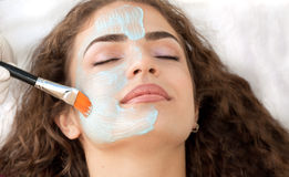 Young  Relaxing Beauty Having Moistening Mask Applied. Royalty Free Stock Photos