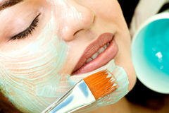 Young  Relaxing Beauty Having Moistening Mask Applied. Royalty Free Stock Images
