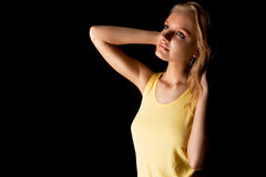 Young relaxing blonde cute girl with sensual look Royalty Free Stock Image
