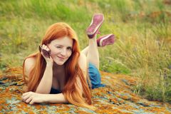 Relaxing redhead girl royalty free stock photo