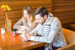 Young Religious Couple Saying Prayer Prior to Eating Stock Photography