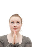 Young religious woman praying to god on white Stock Photo