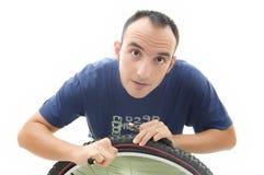 Young repairing bicycle wheel stock photo