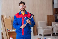 The young repairman carpenter working with clamps Royalty Free Stock Image