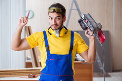 Young repairman carpenter working with power tools electric poli Royalty Free Stock Photo