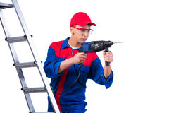 The young repairman with drill perforator isolated on white Stock Photography