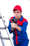 The young repairman with drill perforator isolated on white Stock Photos