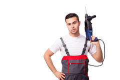 The young repairman with drill perforator isolated on white Royalty Free Stock Images