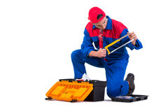 The young repairman with hand saw isolated on white Royalty Free Stock Images