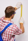 Young repairman with measure tape Stock Photo