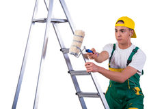 The young repairman painter climbing ladder isolated on white Royalty Free Stock Images