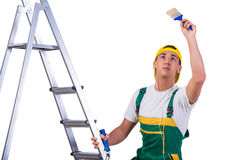 The young repairman painter climbing ladder isolated on white Royalty Free Stock Photos