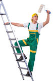 The young repairman painter climbing ladder isolated on white Royalty Free Stock Photography