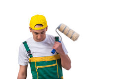 The young repairman painter with roller isolated on white Stock Photo
