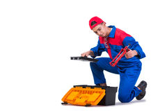 The young repairman with silicone gun isolated on white Stock Images