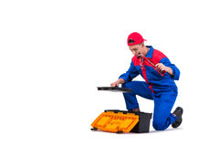 The young repairman with silicone gun isolated on white Royalty Free Stock Photos