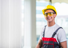 The young repairman working at construction site Royalty Free Stock Photos